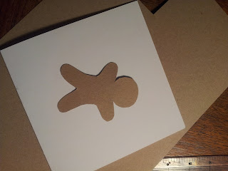 Gingerbread man shape in kraft card
