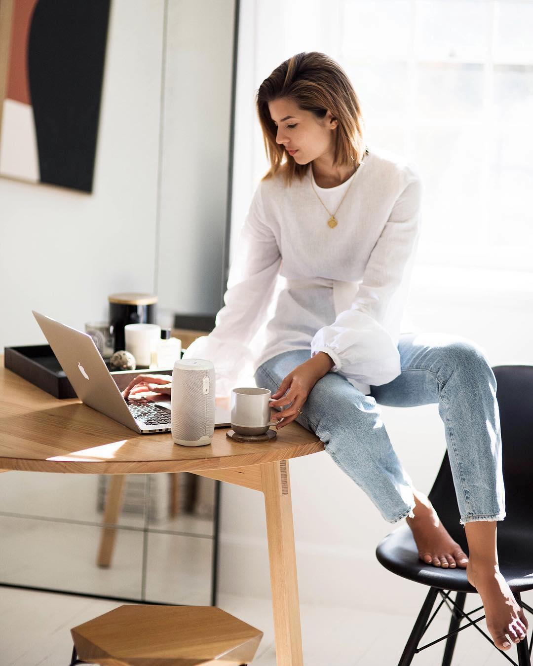 Australian Blogger and Designer Talisa Sutton Summer Outfit Idea — White Linen Top, Gold Medallion Necklace, and Classic Straight-Leg Jeans