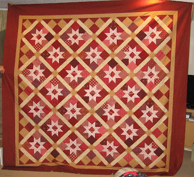 Vintage Sparkle quilt top uses Jelly Bean Stars block and sashing, set on point