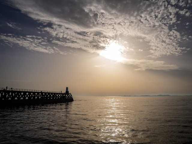 Photo of Maryport Pier and the sun going down over the Solway Firth