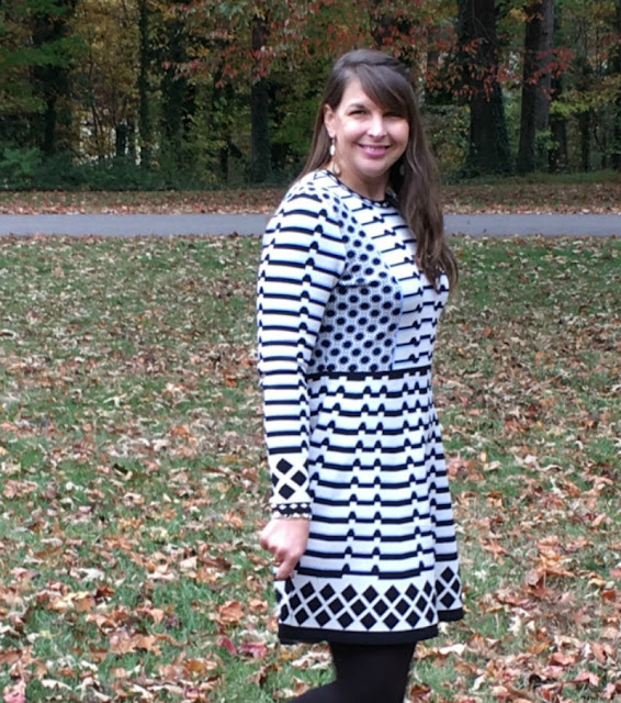 I am making a bold statement by pairing winter white and black together in a geometric print dress and wool coat.