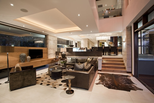 Big living room with black furniture in the Contemporary South African SGNW House by Metropole Architects