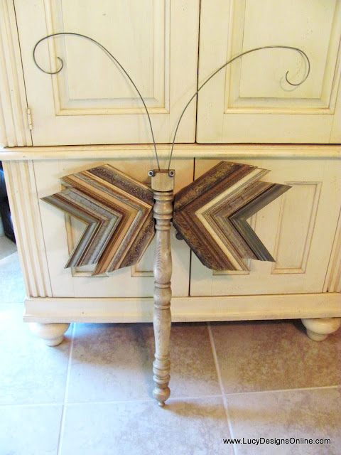 picture molding wings on table leg dragonfly
