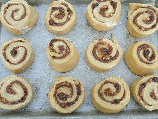 Cinnamon Roll dough buns unbaked in a greased pan.