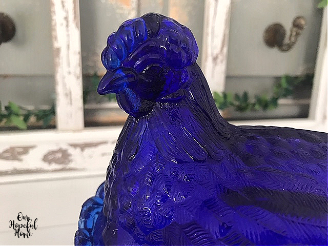 blue glass hen face