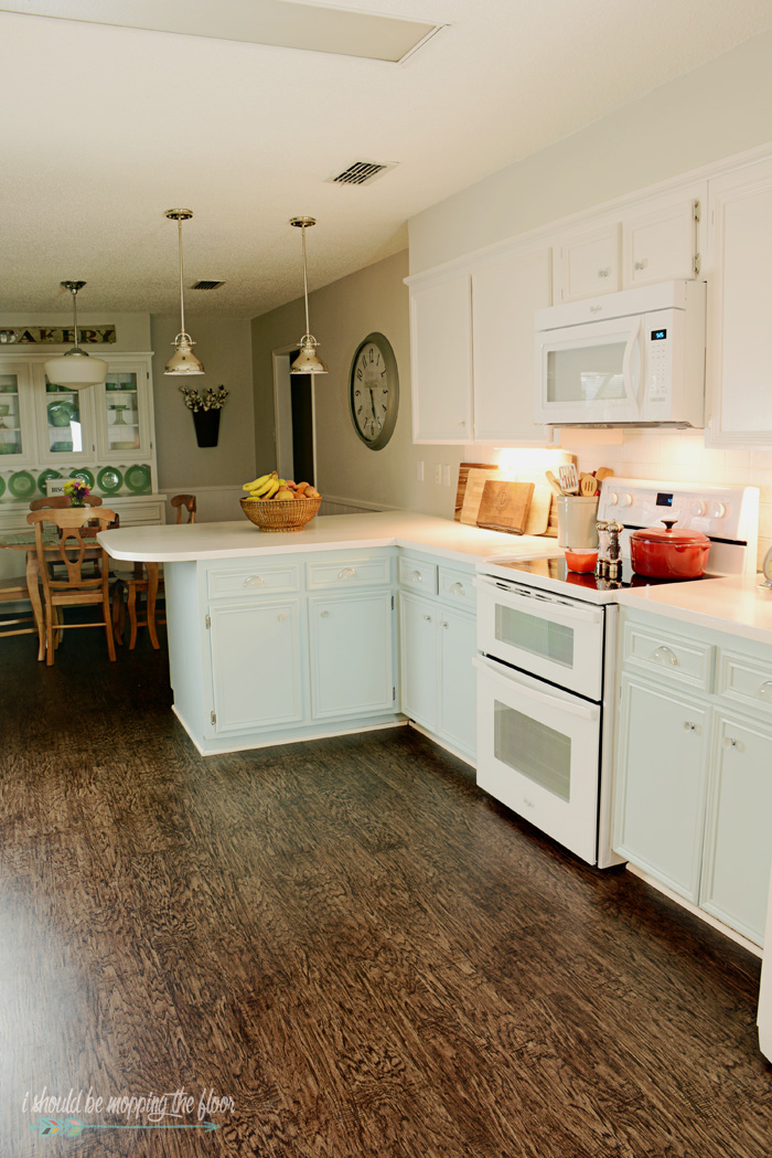 Budget-Friendly Kitchen Makeover | See how they took their kitchen out of the 1970s with a tight budget (and $40 countertops!). Loads of before and after pics.