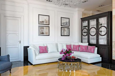 Nifty L-shaped living room design features black and gold floors