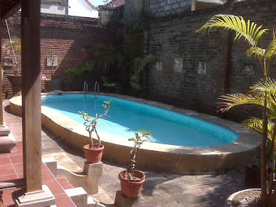 Small pool with etnik decoration backyard  theme