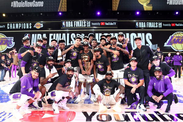 The Los Angeles Lakers take a group photo after winning the 2020 NBA championship at Walt Disney World in Orlando, Florida...on October 11, 2020.