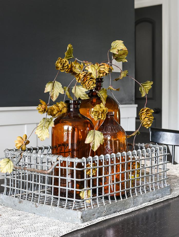 Vintage amber bottles and fall foilage