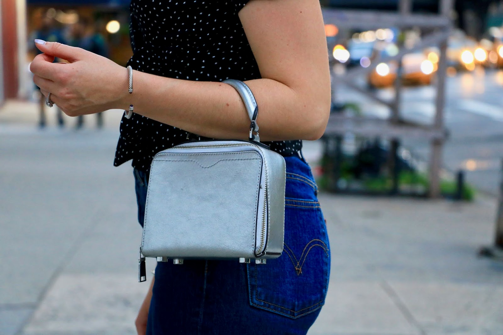 Nyc fashion blogger Kathleen Harper wearing a silver Rebecca Minkoff top handle purse.
