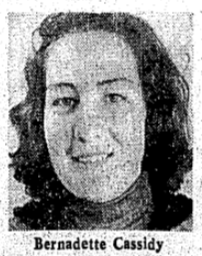 Black and white image of a smiling woman's face