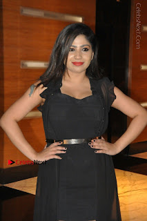 Telugu Actress Model Madhulagna Das Latest Spicy Stills in Black Short Dress  0025.JPG