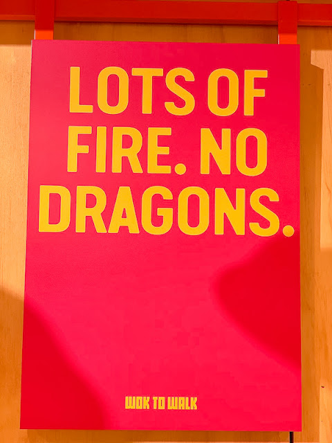 Wok To Walk Leeds, dragon slogan poster