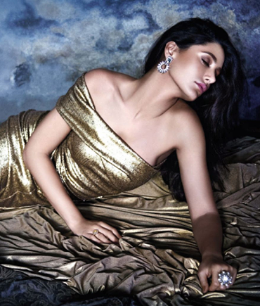 A sizzling shot of Nargis Fakhri in a Donna Karan creation from a 2013 photo shoot for VOGUE India!