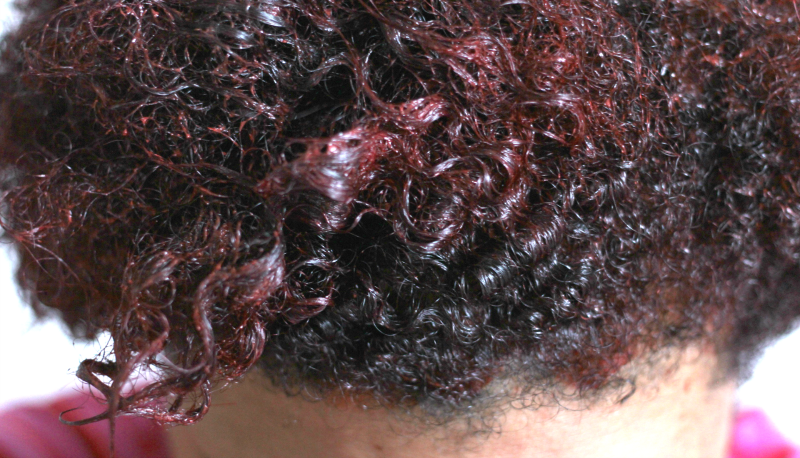 curly hair with red hair dye in it