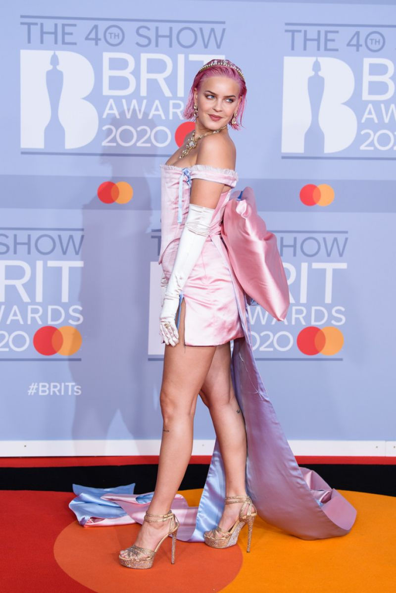 Anne-Marie looks every inch the fairytale princess in a pink silk dress with GIANT bow train