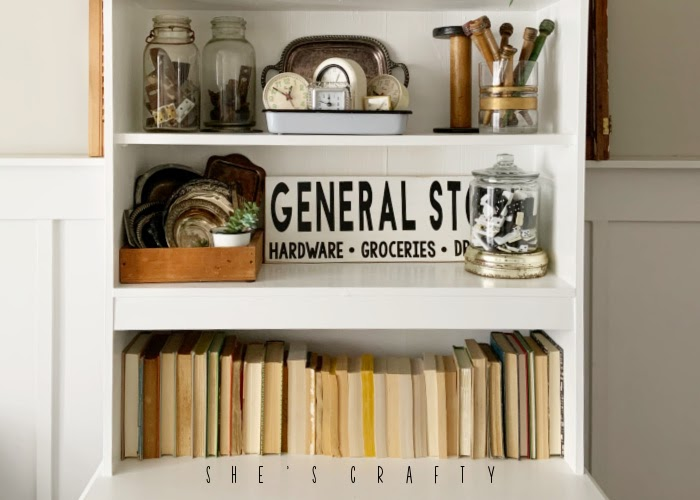 Display vintage books together in a group in a cupboard