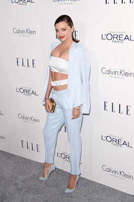 Miranda Kerr flaunts clevage and abs at the Elle Women in Hollywood Awards