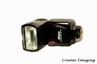 Cramer Imaging's professional quality product photograph of a Nikon SB-700 removable camera flash unit