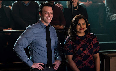 Reid Scott and Mindy Kaling smile backstage while producing a television show in Late Night, the latest movie from Amazon Studios
