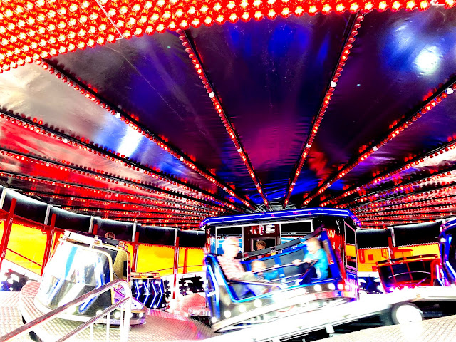 a waltzer at Great Yarmouth Pleasure Beach with lights and blurred people moving quickly