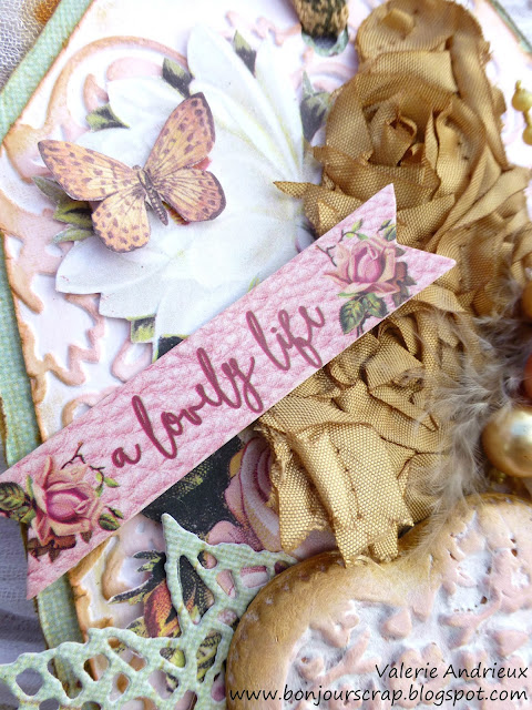 close-up shabby chic tag with Prima Marketing flowers, dies, papers, embossing and fussy cutting