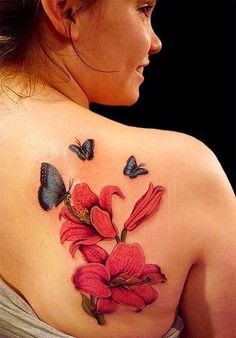 woman tattoss butterfly and flower on back