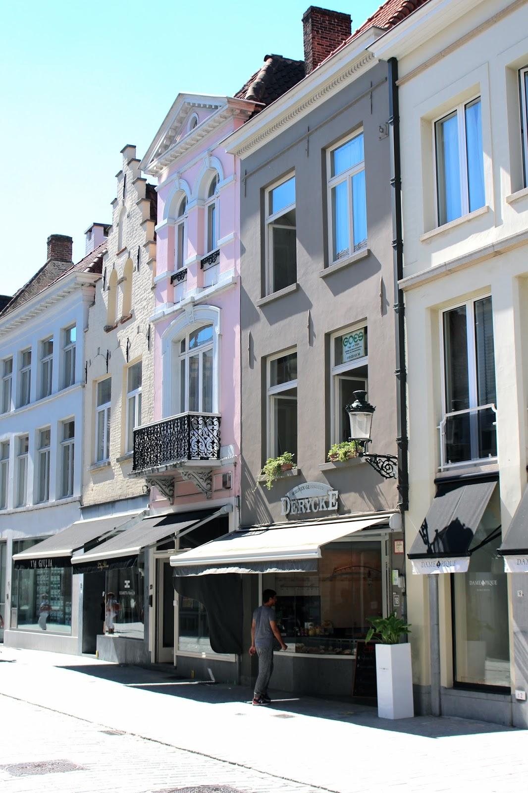Pale pastel coloured architecture in bruges belgium