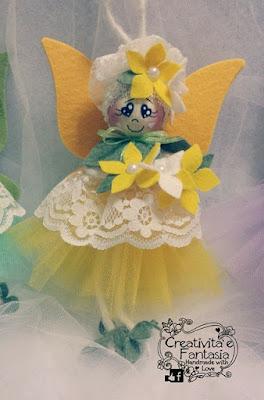 Fatina dei fiori con tulle giallo