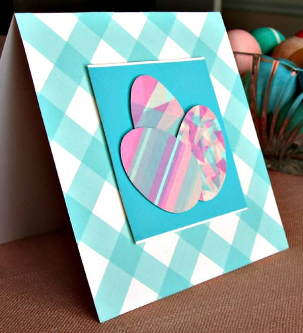 square greeting card with washi tape decorated Easter eggs and diagonal grid background pattern