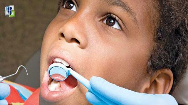 فحص الأسنان للأطفال والكبار