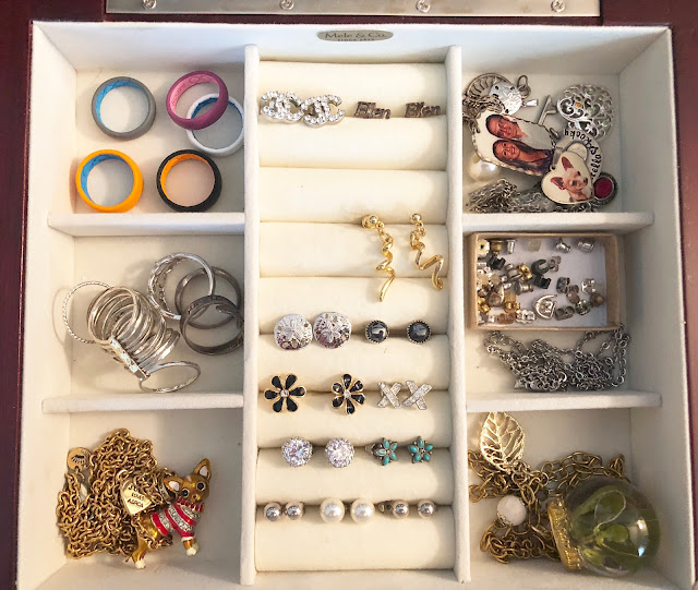 Organized jewelry box with compartments for rings, necklaces, and earrings