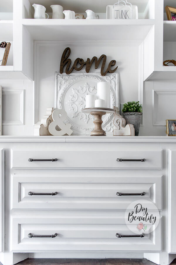 white bookcase with farmhouse decor