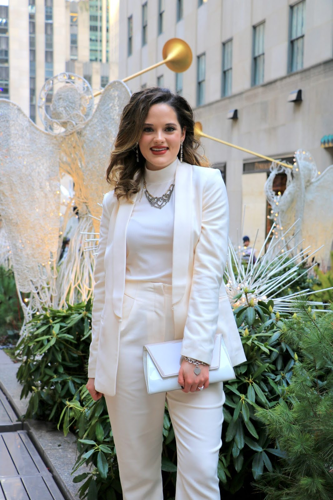 Nyc fashion blogger Kathleen Harper wearing a power suit for the holidays.