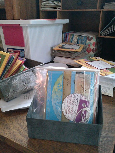 Hand made note cards packaged and ready for display.