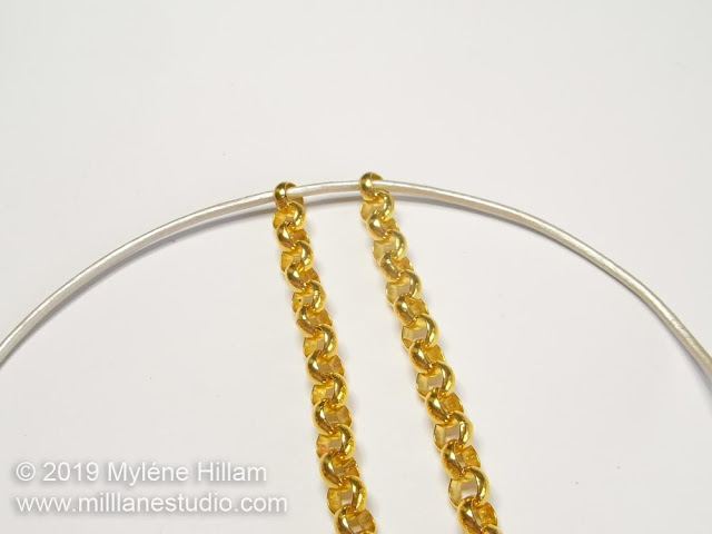 Threading leather cord through the end links of rolo chain