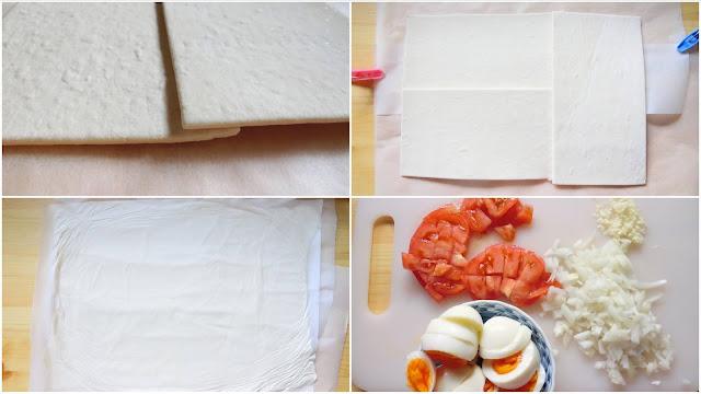 大きめに切ったクッキングシートの上に伸ばせるくらいに解凍した冷凍パイシート2枚を1㎝ど重ねるように横向きして上下に並べ、もう1枚を縦に置いて1㎝重ねるように配置します。 大きめに切ったクッキングシートで挟んで麺棒で横40㎝×縦30㎝くらいの大きさに薄く伸ばし、使う時まで冷蔵庫で平らになるように冷やしておきます。  トマトは角切り、玉ねぎとにんにくはみじん切りに切ります。