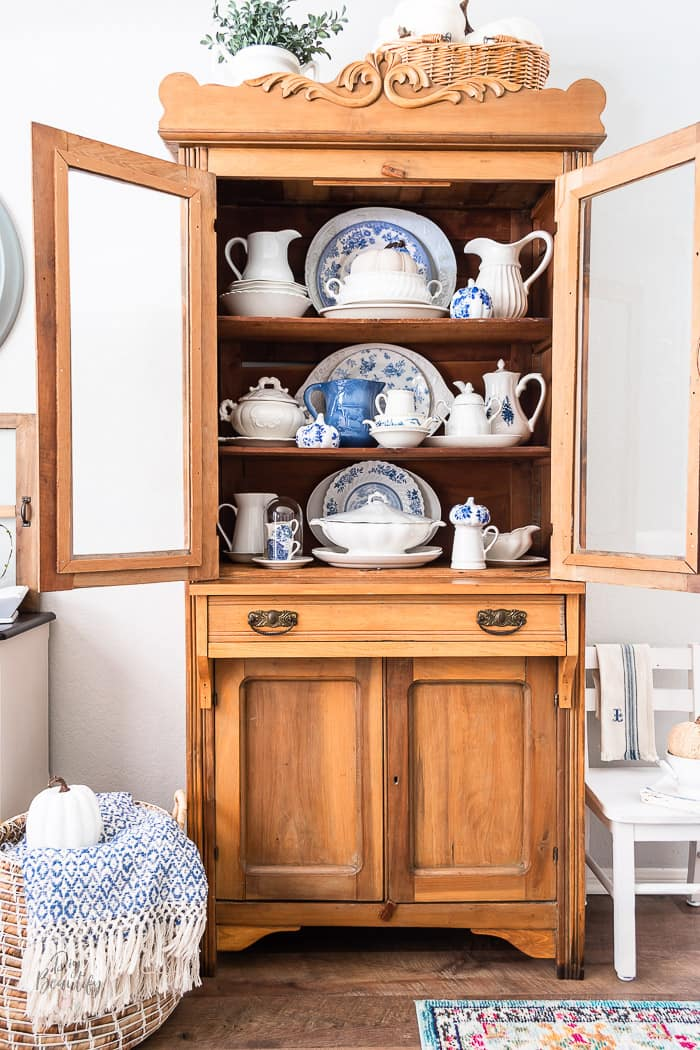 pine hutch with white ironstone, blue and white transferware and decoupage pumpkins