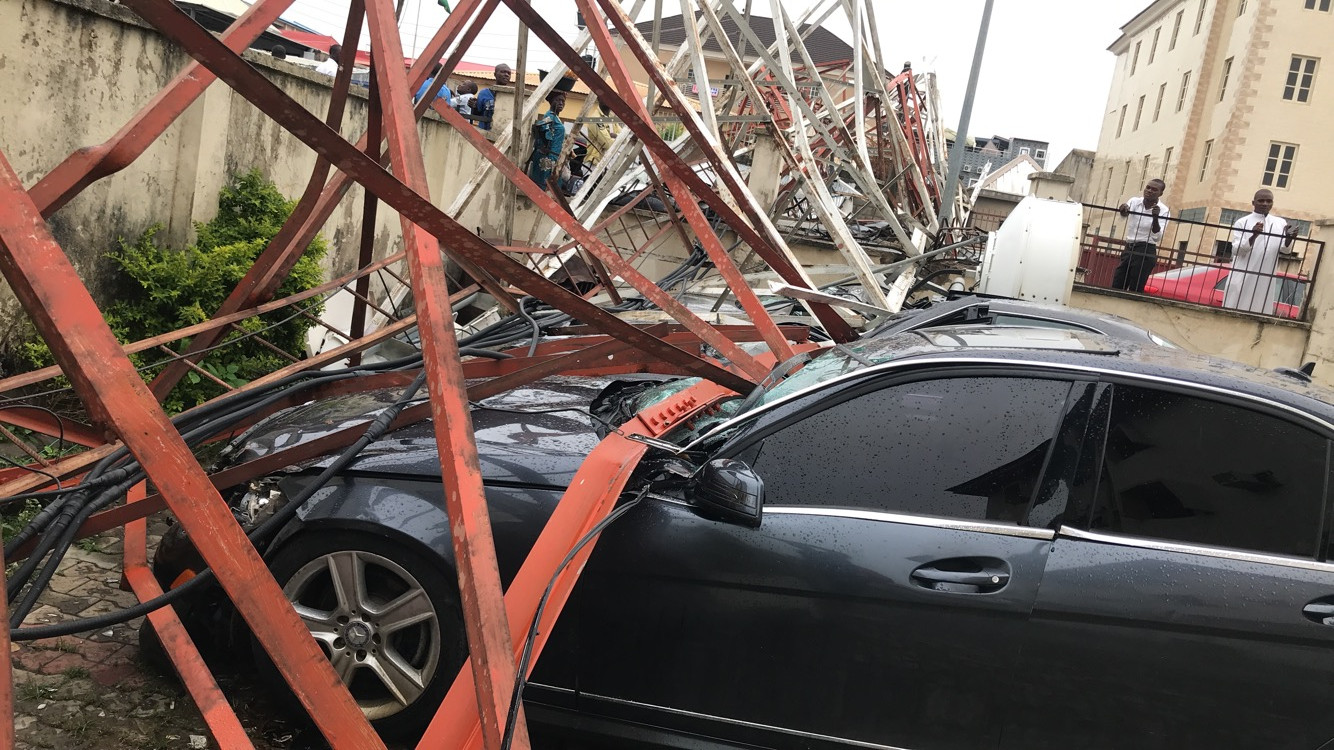 Aerial mast collapses in Abuja, destroy cars and other properties
