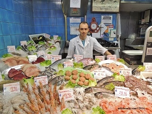Photo taken in Isola, Milan, of a fish market vendor in the Mercato Comunale Lagosta