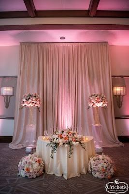 Pink sweetheart table with flowers
