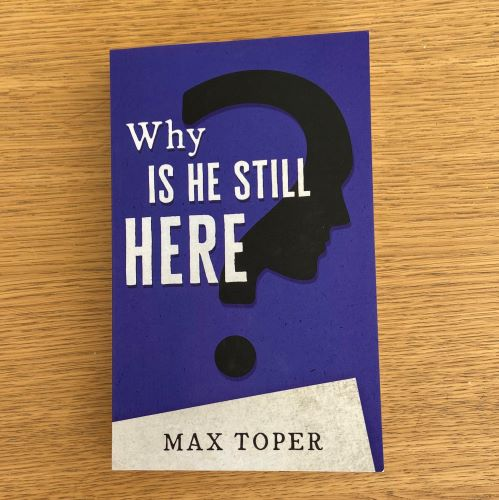 Purple book cober with text why is he still here and author name max toper, with black question mark with shadow of a head on it