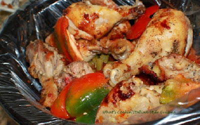 slow cooker chicken cacciatore in a large black liner pot with peppers on top