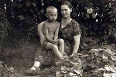 Vladimir Putin in childhood with his Mother Maria Shelomova.