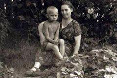 Vladimir Putin in childhood with his Mother Maria Shelomova.