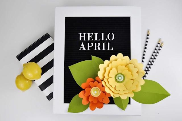 Adding flowers to a letter board by Jen Gallacher for www.jengallacher.com #letterboard #jengallacher #paperflower
