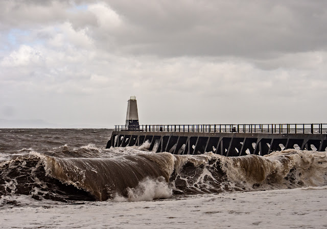 Photo of a giant wave breaking on the shore at Maryport during Storm Hector