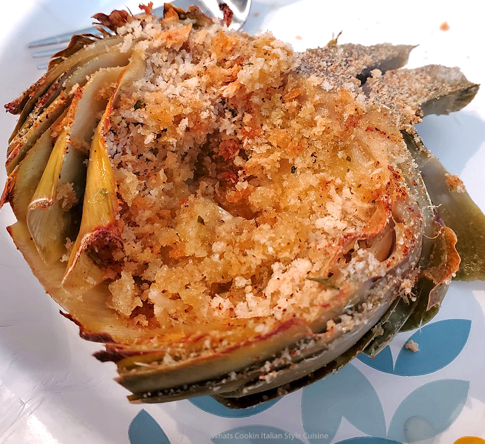 this is a stuffed artichoke filled with bread crumb and garlic with herbs and spices