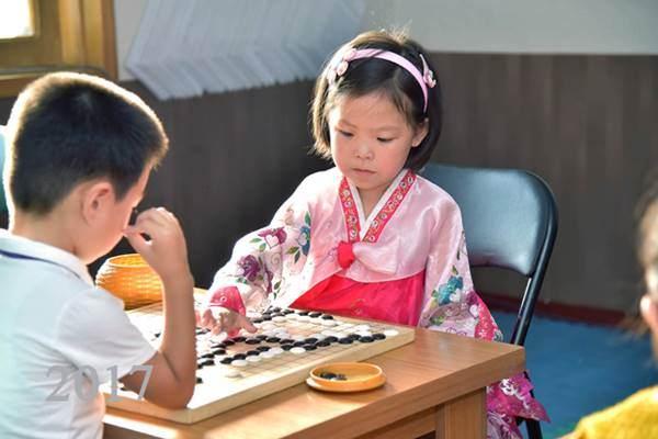 Nursery Children Playing Paduk